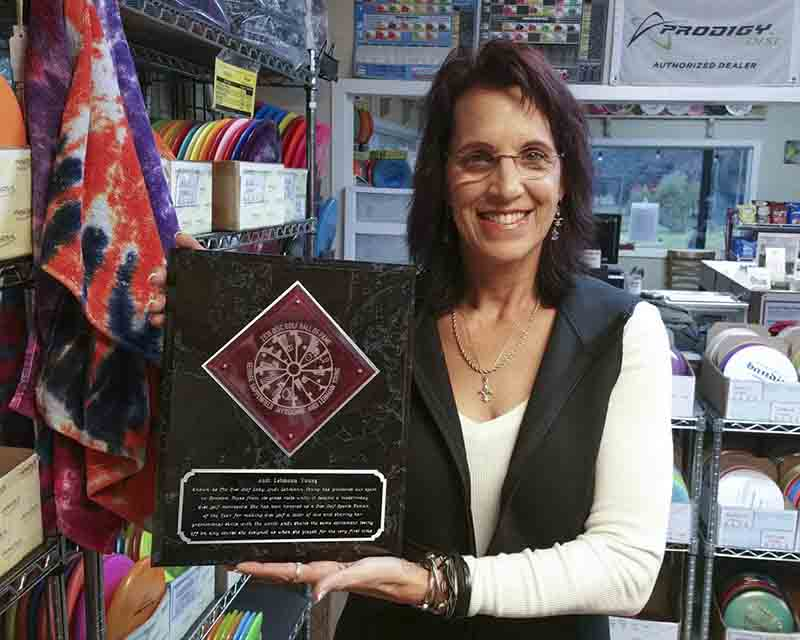 Andi Lehmann Young with her Disc Golf Hall of Fame Plaque